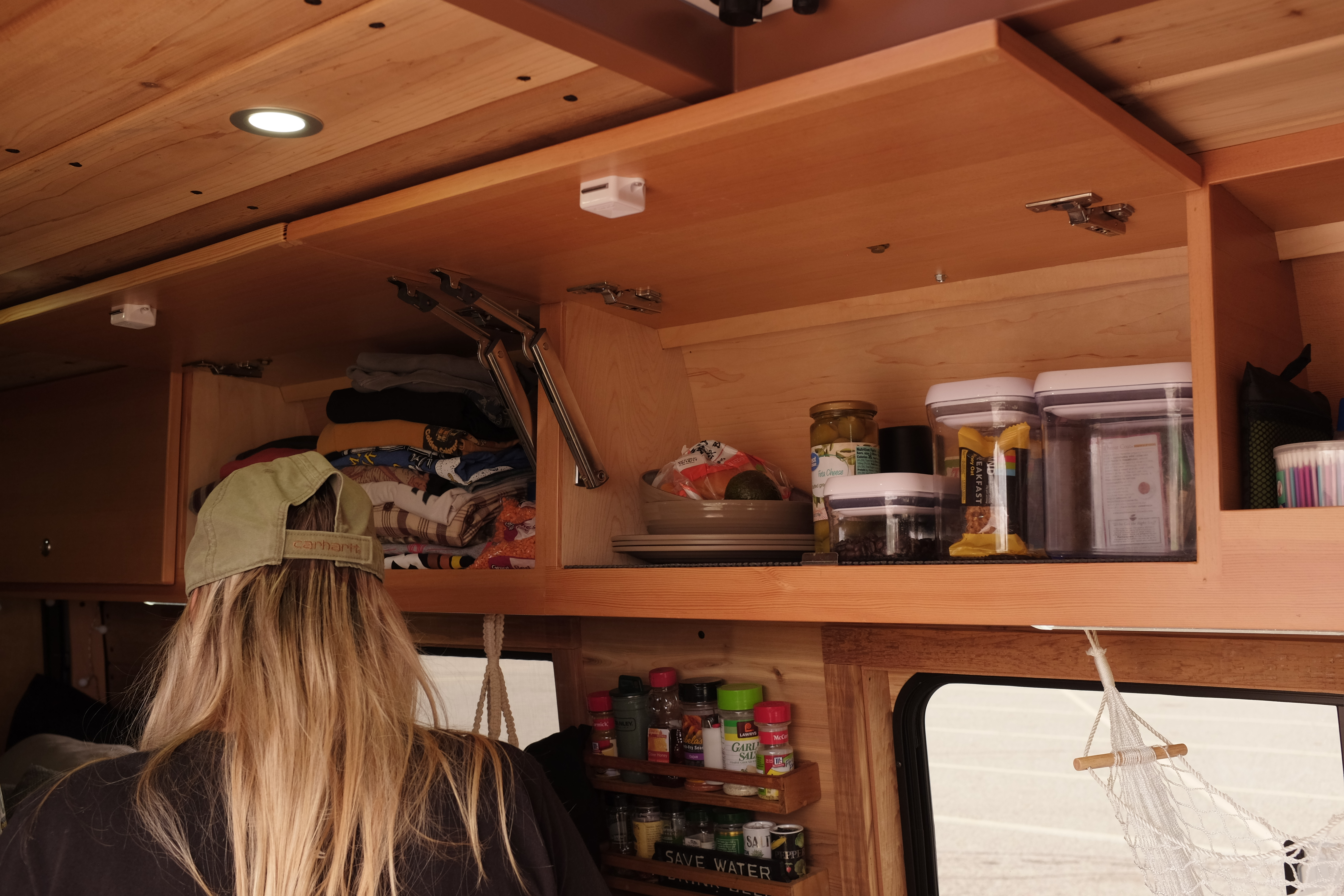 katie cooking dinner in so we bought a van sprinter conversion
