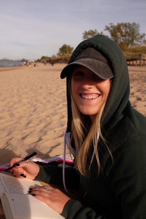 katie journaling on the beach at lake michigan