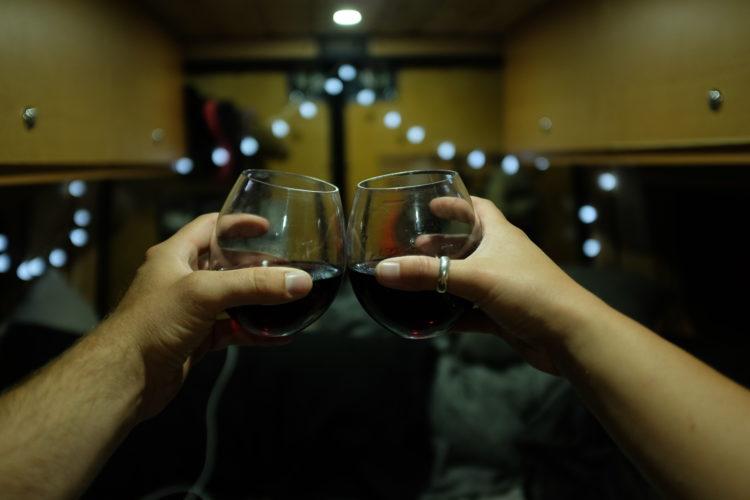 drinking wine in sprinter camper van